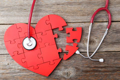 Red puzzle heart Stock Images