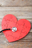 Red puzzle heart with stethoscope Stock Photo