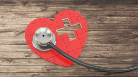Red puzzle heart with stethoscope Royalty Free Stock Photography