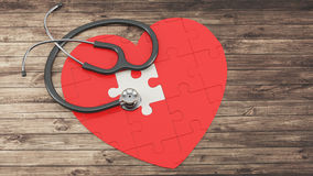 Red puzzle heart with stethoscope Royalty Free Stock Photos
