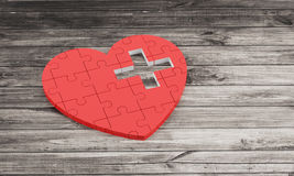 Red puzzle heart with white cross Stock Image