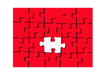 Red puzzle with one white piece. All red puzzle design with one sole white or missing piece standing out in the center and a white border around entire puzzle Stock Photos