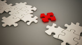 Red puzzle part standing between white puzzle parts. 3D illustration Royalty Free Stock Photo