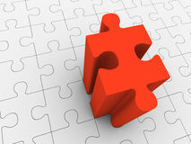 Red puzzle piece projecting from grey puzzle Stock Images