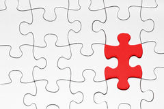 Red puzzle piece. On white background royalty free stock image