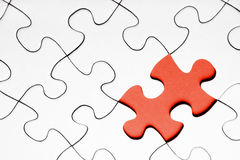 Red puzzle piece. On white background stock photo