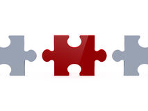 Red Puzzle Piece Among White Ones Royalty Free Stock Photography