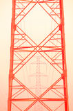 The red pylon. The red iron electric pylon stock photography