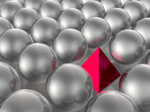 Red pyramid and grey spheres Royalty Free Stock Image