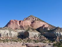 Red Pyramid Rock Mountain with blue sky on a beautiful desert day in southwestern united states in New Mexico. royalty free stock image
