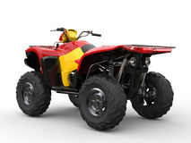 Red quad bike with yellow side panels Royalty Free Stock Photo