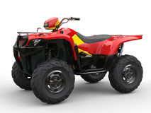 Red quad bike with yellow side panels Stock Photo