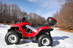 Red quad in snow Royalty Free Stock Image