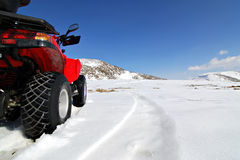 Red quad in snow Royalty Free Stock Photo