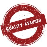 Red QUALITY ASSURED rubber stamp illustration on white background. Image Stock Image