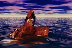 Red quartz crystal. Over the sea Stock Image