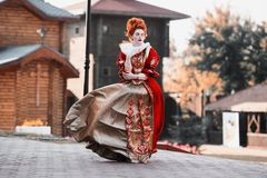Beautiful girl with red hair. Red Queen in the castle. Red-haired woman in a chic vintage dress. Fashion Photo royalty free stock photography