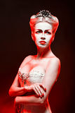 Red Queen. With a crown and a corset, with make-up in studio shot Royalty Free Stock Photography