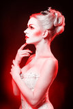 Red Queen. With a crown and a corset, with make-up in studio shot Royalty Free Stock Image