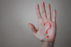 Red Question Mark on a Hand Stock Photos