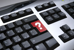 Red question mark on keyboard Royalty Free Stock Photos