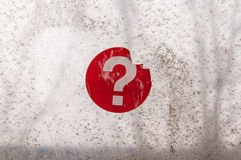 Red question mark sticker on an old window. Red question mark sticker on an old weathered window Royalty Free Stock Photo