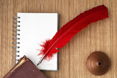 Red quill pen with blank note for text Stock Image