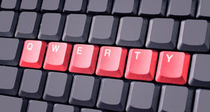 Red qwerty button on keyboard. Close-up Stock Photography