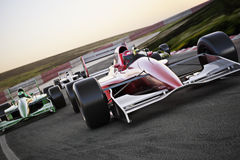 Red race car close up front view on a track leading the pack with motion Blur. Royalty Free Stock Image