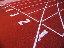 Red racetrack on the stadium Royalty Free Stock Images