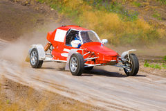 Red racing buggy on track. Red racing buggy on dirt track royalty free stock images