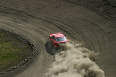 Red racing car. Racing car driving on a racing track Royalty Free Stock Photo