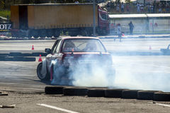 Red racing modified car drifting Royalty Free Stock Images