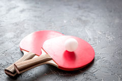 Red racket for ping pong ball gray background close up Stock Photos