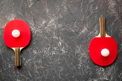 Red racket for ping pong ball gray background top view Stock Images