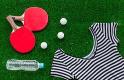 Red racket for ping pong ball green background close up Royalty Free Stock Image