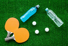 Red racket for ping pong ball green background close up Stock Photography