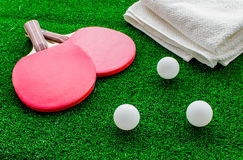 Red racket for ping pong ball green background close up Royalty Free Stock Images