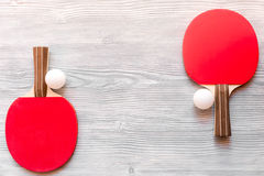 Red racket for ping pong ball wooden background top view Royalty Free Stock Image