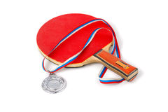 Red racket tennis and a silver medal Stock Photography