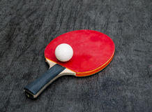 Red Racquet and ball tables tennis balls. Lay on a wooden table Royalty Free Stock Photo