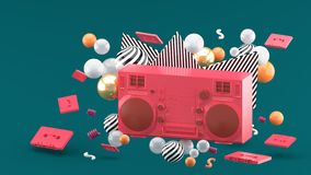 Red radio amidst colorful balls on a green background. royalty free illustration