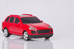Red radio control car. On gray background Royalty Free Stock Photo