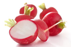 Red radish cut in half Stock Photos