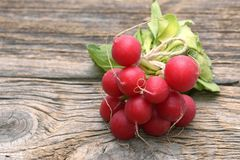 Red radish on wooden background. Red radish on wooden background Royalty Free Stock Photos