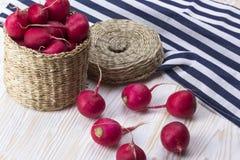 Red radishes in a basket. Red radishes in a basket on wooden desk Stock Photos
