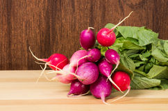Red radishes bunched in the kitchen Royalty Free Stock Photo