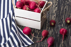 Red radishes in a wooden box. Stock Photography