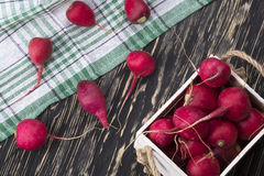 Red radishes in a wooden box. Stock Photos