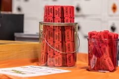 Red raffle tickets in jar. Close view at ribbons of red raffle tickets in a glass jar royalty free stock images